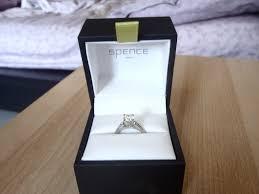 wedding ring in a box engagement rings smashing through