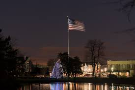 lit christmas tree and flag u2013 joe benning photography