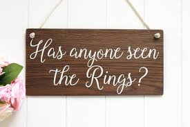 has anyone seen the rings page boy sign rustic wooden
