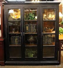 distressed black 3 door paned glass bookcase the bookcase has 3