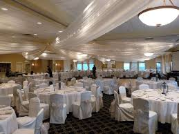ceiling draping ivory ceiling draping ivory chair covers with chagne organza