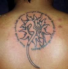glowing om tattoo on upper back for boys picsmine