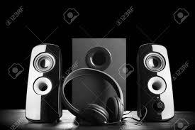 modern speakers modern black sound speakers and headphones on dark background