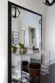 Clear Console Table Clear Console Table In Front Of Black Leaning Mirror