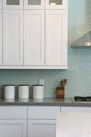 white kitchen cabinets with blue subway tile two amazing kitchens and a faucet