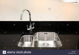 modern contemporary kitchen sink mixer tap and marble work