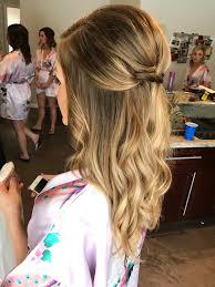 bridesmaid or bridal hairstyle loose curls half up half down updo