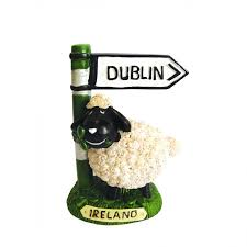 sheep on grass with dublin road sign ornamental statue