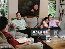 in livingroom family hanging out in living room stock photo getty images