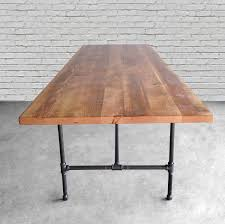 solid wood dining table with reclaimed wood top and iron pipe