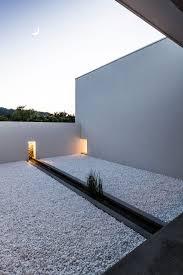 minimalist japanese house built around a zen garden by architect
