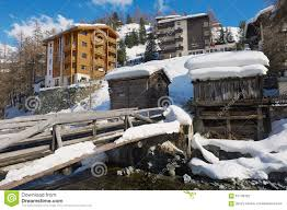 view to the hotels and historical wooden buildings in zermatt
