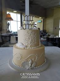 classic 2 tier beach wedding cake with coral detail croissants
