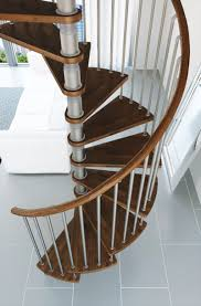 gamia argento spiral staircase with wooden handrail architecture
