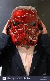curator ben moore wears a stormtrooper helmet by artist sir anish
