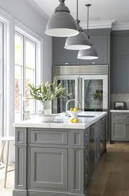 pics of kitchens with white cabinets and gray walls the psychology of why gray kitchen cabinets are so popular