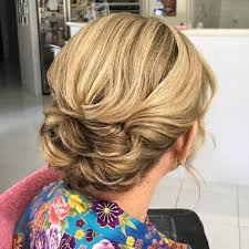 upsweep hairstyles for older women 40 stylish long hairstyles for older women twist bun bun updo