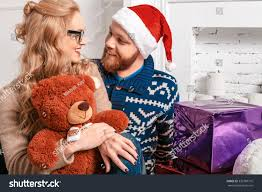 beautiful couple santa hat gifts by stock photo 336789716