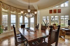 Sarah Richardson Dining Rooms Curved Staircase In Two Story Foyer With Pillars Leading To Dining