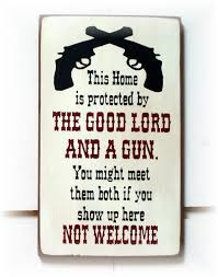 this home is protected by the good lord and a gun wood sign this home is protected by the good lord and a gun wood sign western sayingscountry western decorwestern