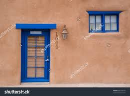 adobe house blue door window stock photo 89150359 shutterstock