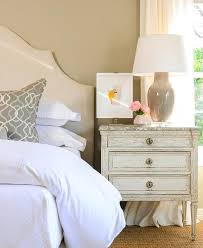 cream arch headboard with silver and gray trellis pillow