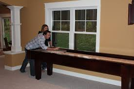 Shuffle Board Tables A Guide To Shuffleboard Sizes And Your Homemcclure Tables