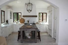 reclaimed wood french kitchen hood with marble cooktop backsplash