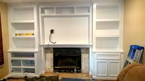 fireplace wall unit with bookcases in lacquer