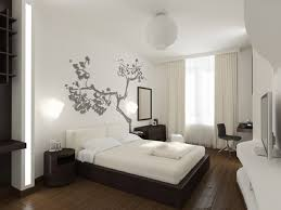 gray tree painting on the wall as background in the bedroom
