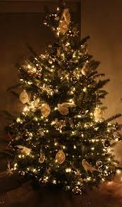 white tree lights happy holidays