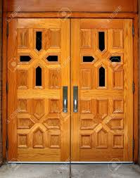 set of double wooden church doors with cross patterns stock photo