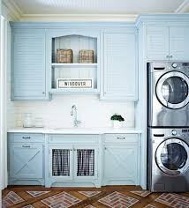 laundry room upper cabinets blue louvered laundry room cabinets cottage laundry room