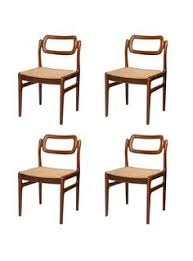 Indian Dining Chairs A Set Of Four Modern Arm Chairs In Black Leather And Chrome From