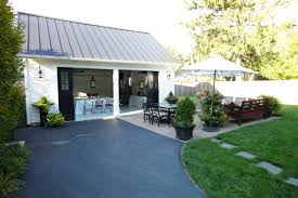 garage exterior renovation black metal roof cape cod lights