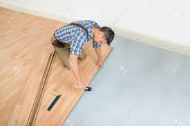 Laminated Timber Floor Carpenter Installing New Laminated Wooden Floor At Home Stock