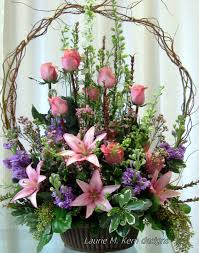 Funeral Flower Bouquets - willow basket filled with pink lilies pink rose buds assorted