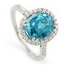 blue zircon rings images Blue zircon ring with diamond halo in white gold jpg