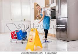 How To Clean Kitchen Floors - happy woman cleaning floor mop kitchen stock photo 302060318