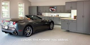 garage flooring storage organization living gray ferrari parked large garage with lots dark cabinetry