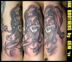 fantastic black and white seductive female joker tattoo on biceps