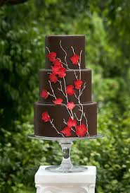 three tier brown fall wedding cake with red leaves deer pearl