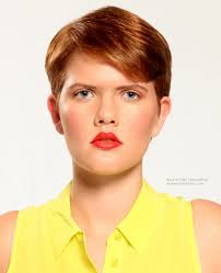 short tomboy haircut for red hair with a diagonal fringe