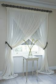 Floor Length Curtains Overlapping Sheer Panels To Accentuate The Height Of A Room Hang