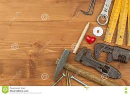 set of tools and instruments on wooden background different kinds