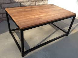 small rectangle industrial butcher block table with wooden top and