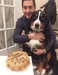 dog is absolutely thrilled about her birthday cake