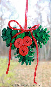 pine cone holly ornament winter and christmas arts and crafts for