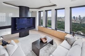 white sofa wooden flooring monitor window garden ceiling white