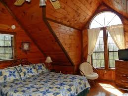 Wood Paneling Walls by Rustic Guest Bedroom With Wood Panel Wall U0026 Arched Window In